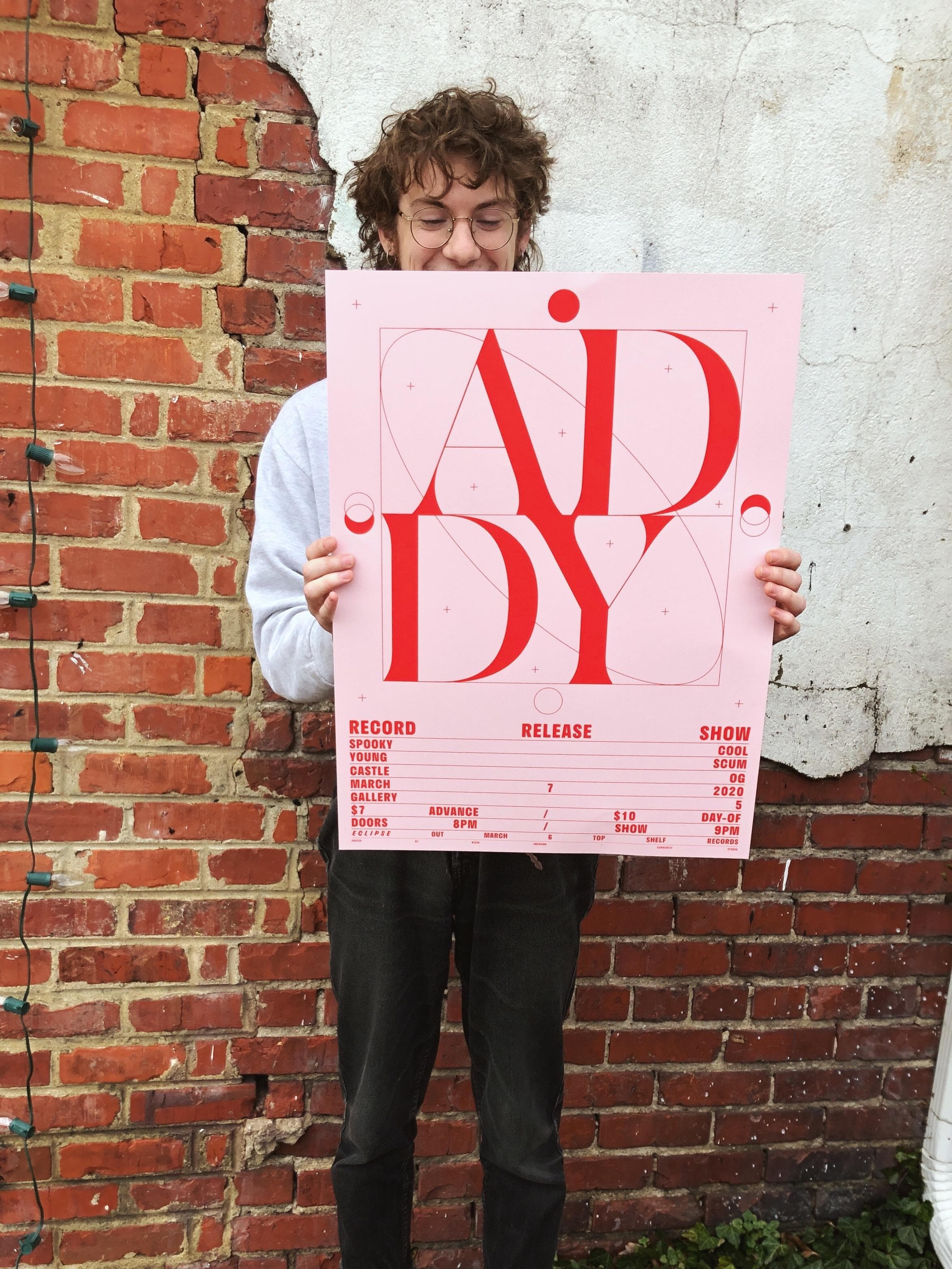 Addy holding the poster for their record release show